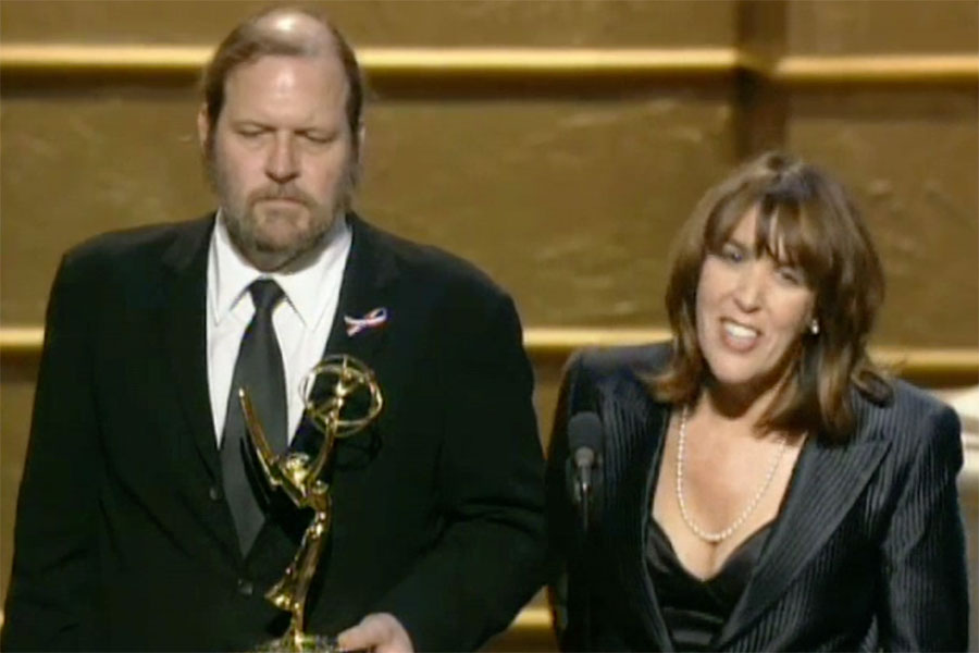 Mitchell Burgess And Robin Green Accept The Emmy For