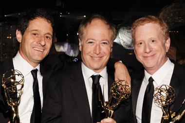 "(L-R) Co-Executive Producers for ""Modern Family"" Bill Wrubel, Danny Zuker and Jeff Morton pose with their awards."