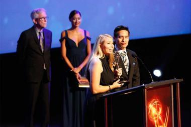 Bettina Shore and Nikolas Kuo accept an award at the 68th Los Angeles Area Emmys, July 23, 2016, at the Saban Media Center, North Hollywood, California.