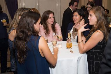 Dina Muradian, Tiffany Tulba, and Jenna Martone chat with friends at the New York Networking Night Out, November 13, 2015 at the St. Regis in New York City.