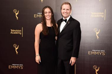 President and Chief Operating Officer, Maury McIntyre and guest arrive on the red carpet at the 2016 Creative Arts Emmys.