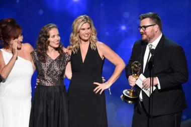 The hairstyling team from The People V. O.J. Simpson: American Crime Story accepts an award at the 2016 Creative Arts Emmys.