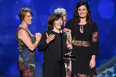 The hairstyling team from Downton Abbey accepts their award at the 2016 Creative Arts Emmys.