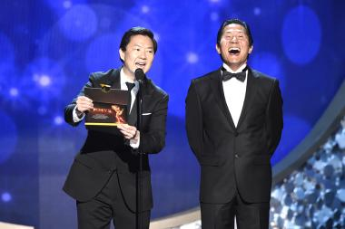 Ken Jeong, left, and stuntman Phil Tan speak on stage at the 2016 Creative Arts Emmys.