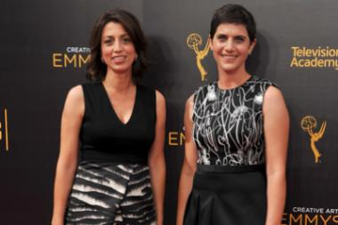 Laura Ricciardi and Moira Demos on the red carpet at the 2016 Creative Arts Emmys.