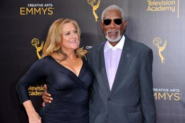 Lori McCreary and Morgan Freeman on the red carpet at the 2016 Creative Arts Emmys.