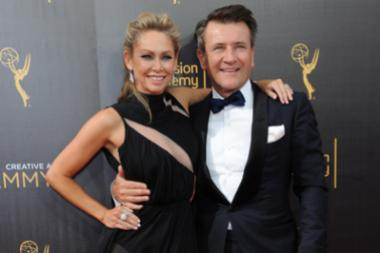 Kym Johnson and Robert Herjavec on the red carpet at the 2016 Creative Arts Emmys.