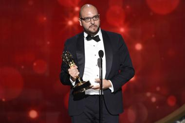 Anthony Miale accepts an award at the 2016 Creative Arts Emmys.