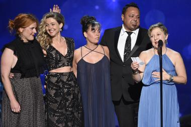 The hairstyling team from Saturday Night Live accepts an award at the 2016 Creative Arts Emmys.