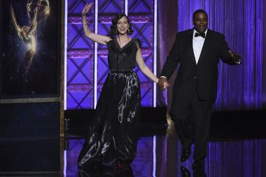 Kristen Schaal and Kenan Thompson on stage at the 2017 Creative Arts Emmys.