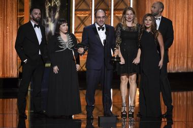The Saturday Night Live team accepts an award at the 2017 Creative Arts Emmys.