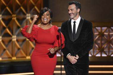Niecy Nash and Reid Scott on stage at the 2017 Creative Arts Emmys.