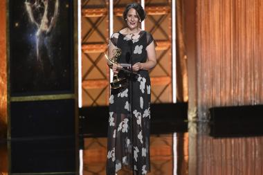 Jennifer Lilly accepts an award at the 2017 Creative Arts Emmys.