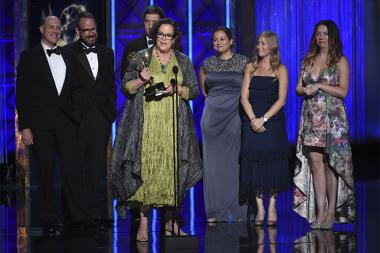 The team of Once Upon a Sesame Street Christmas accepts their award at the 2017 Creative Arts Emmys.