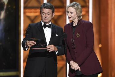 John Michael Higgins and Jane Lynch on stage at the 2017 Creative Arts Emmys.