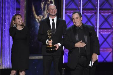 Janet Gegan, wife of winner Gary Gegan, Clark Germain, and Andy D'Addario accept their award at the 2017 Creative Arts Emmys.