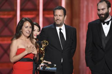 The team from Stranger Things accepts their award at the 2017 Creative Arts Emmys.