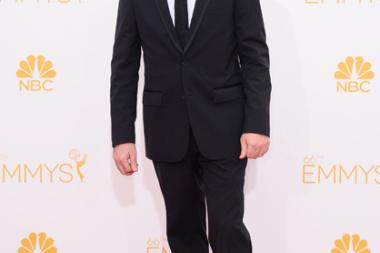 Dana Brunetti arrives at the 66th Emmy Awards.
