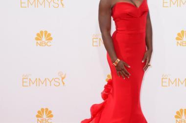 Uzo Aduba of Orange Is the New Black arrives at the 66th Emmy Awards.