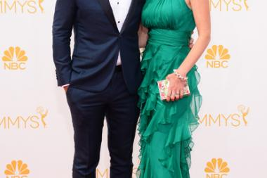 Ty Burrell of Modern Family and Holly Burrell arrive at the 66th Emmys.