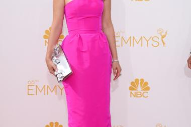Zooey Deschanel of New Girl arrives at the 66th Emmy Awards.