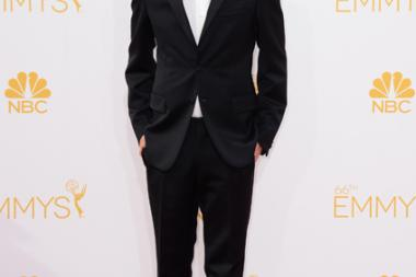 Aaron Paul of Breaking Bad arrives at the 66th Emmys.