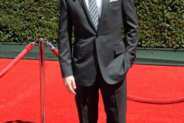 Jason Dolley arrives for the 2014 Primetime Creative Arts Emmys.