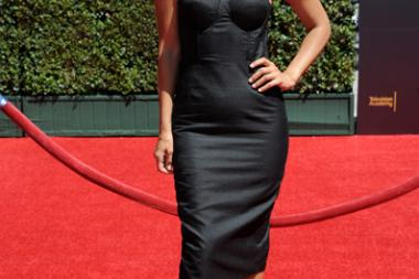 Liz Hernandez arrives for the 2014 Primetime Creative Arts Emmys.
