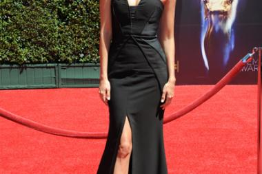 Renee Bargh arrives for the 2014 Primetime Creative Arts Emmys.