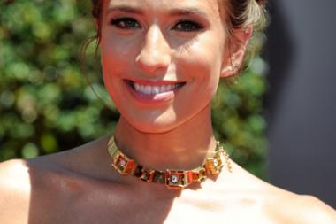 Renee Bargh arrives for the 2014 Primetime Creative Arts Emmys.