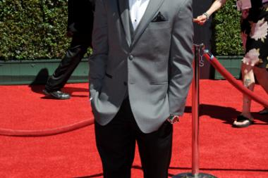 Bradley Steven Perry arrives for the 2014 Primetime Creative Arts Emmys.