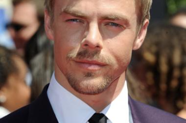 Derek Hough of Dancing with the Stars arrives for the 2014 Primetime Creative Arts Emmys.