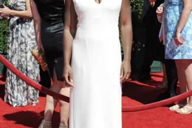 Uzo Aduba arrives for the 2014 Primetime Creative Arts Emmys.