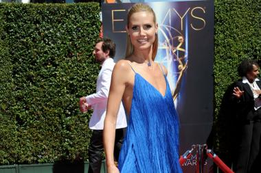 Heidi Klum arrives for the 2014 Primetime Creative Arts Emmys.