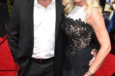 Sig Hansen and June Hansen arrive for the 2014 Primetime Creative Arts Emmys.
