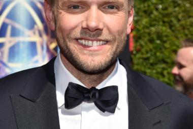 Joel McHale of The Soup arrives for the 2014 Primetime Creative Arts Emmys.