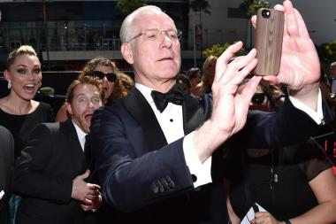 Tim Gunn of Project Runway arrives for the 2014 Primetime Creative Arts Emmys.