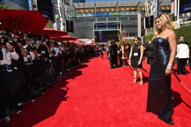 Laverne Cox of Orange Is the New Black arrives for the 2014 Primetime Creative Arts Emmys.
