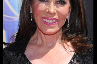 Kate Linder arrives for the 2014 Primetime Creative Arts Emmys.