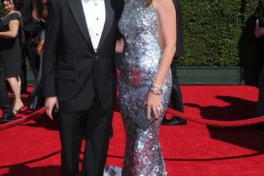 Peter Yozell, and Janie Bryant arrive for the 2014 Primetime Creative Arts Emmys.