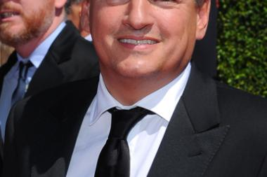 Ted Sarandos arrives for the 2014 Primetime Creative Arts Emmys.