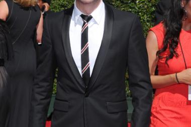 Chris Hardwick arrives for the 2014 Primetime Creative Arts Emmys.