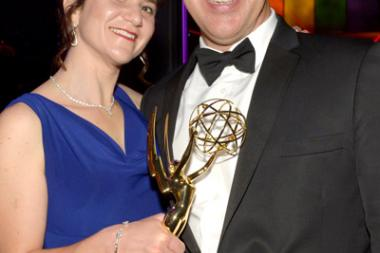 Susan Cahill (l) and Bill Cahill (r) celebrate at the 2014 Creative Arts Emmys ball.