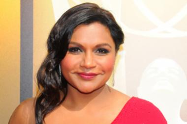 Mindy Kaling arrives on the red carpet at the Creative Arts Emmy Awards 2015.