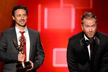 Kyle Dunnigan and Jim Roach accept an award at the 2015 Creative Arts Emmys.