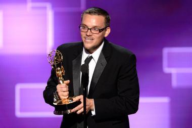 Justin Lebens accepts an award at the 2015 Creative Arts Emmys.