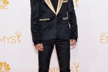 Mason Vale Cotton of Mad Men arrives at the 66th Emmys.