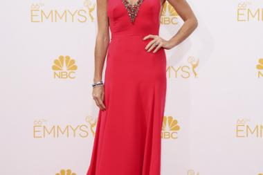 Minnie Driver of About A Boy arrives at the 66th Emmy Awards.