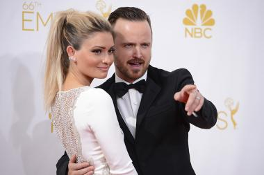 Lauren Parsekian (l) and Aaron Paul of Breaking Bad arrive at the 66th Emmy Awards.