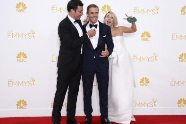 Jimmy Fallon (l) Derek Hough (c) and Julianne Hough (r) arrive at the 66th Emmy Awards.